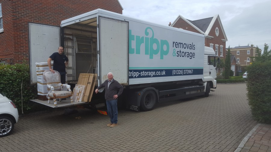 Tripp Removals unloading furniture from removal van surrey