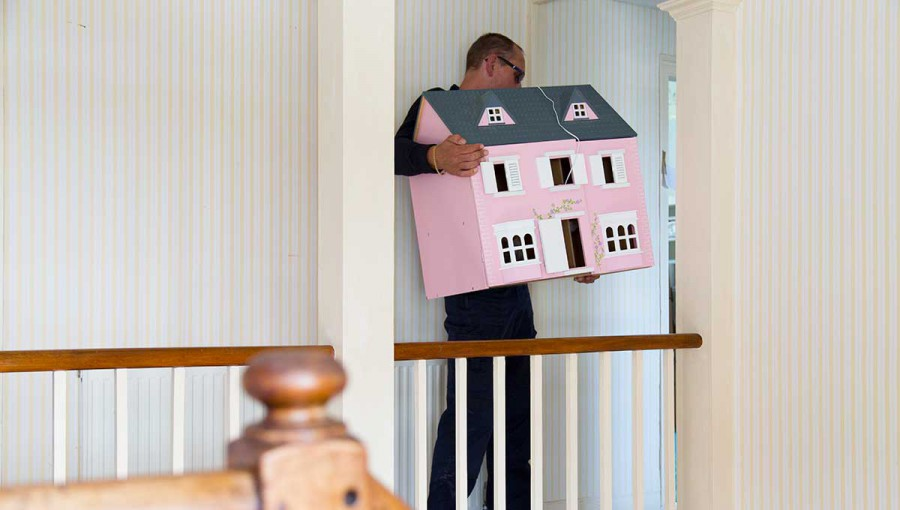 Tripp removals carrying dolls house upstairs