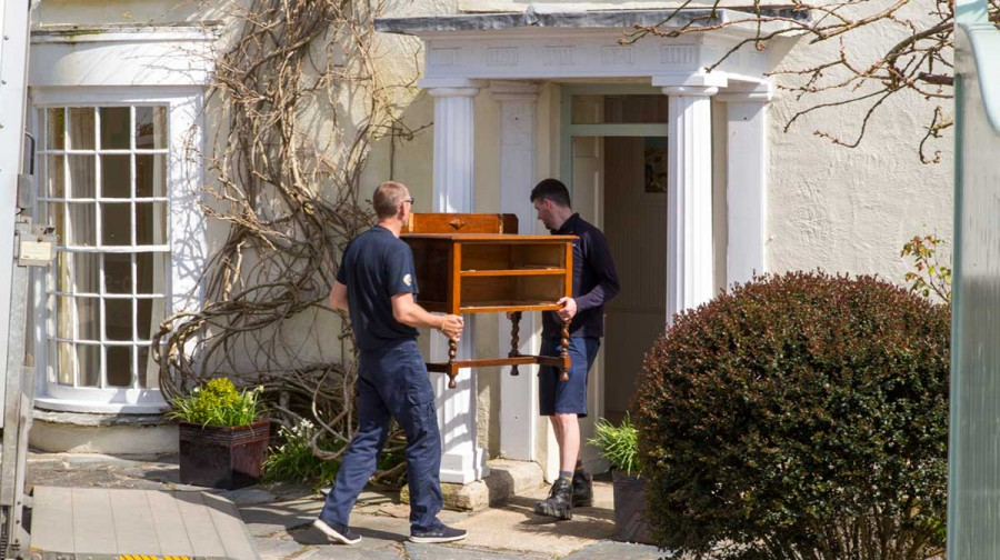 Tripp removals staff unload side table